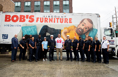 Bob's Discount Furniture teams up with the New York Giants to honor Jersey City Fire Dept.